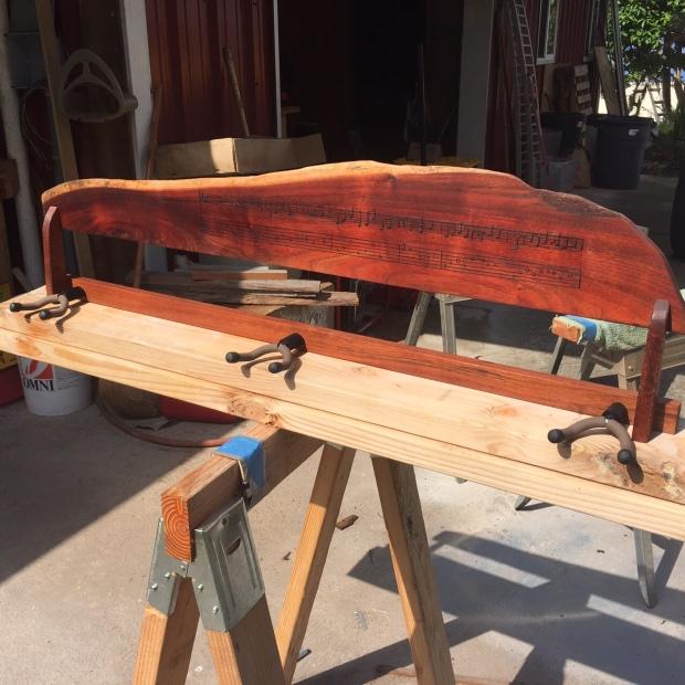 Tripple ukulele rack with wood burned musical score
